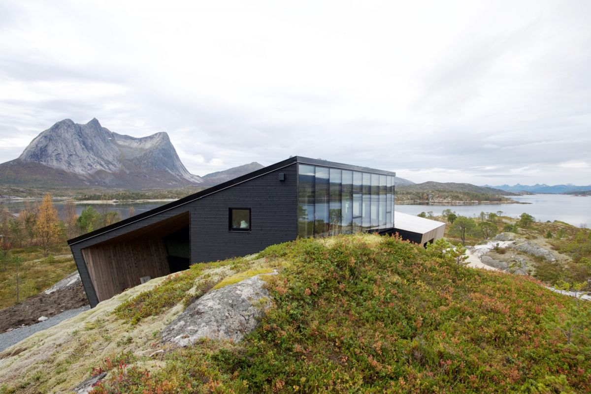 the exterior facades of both volumes feature a combination of pinewood and glass