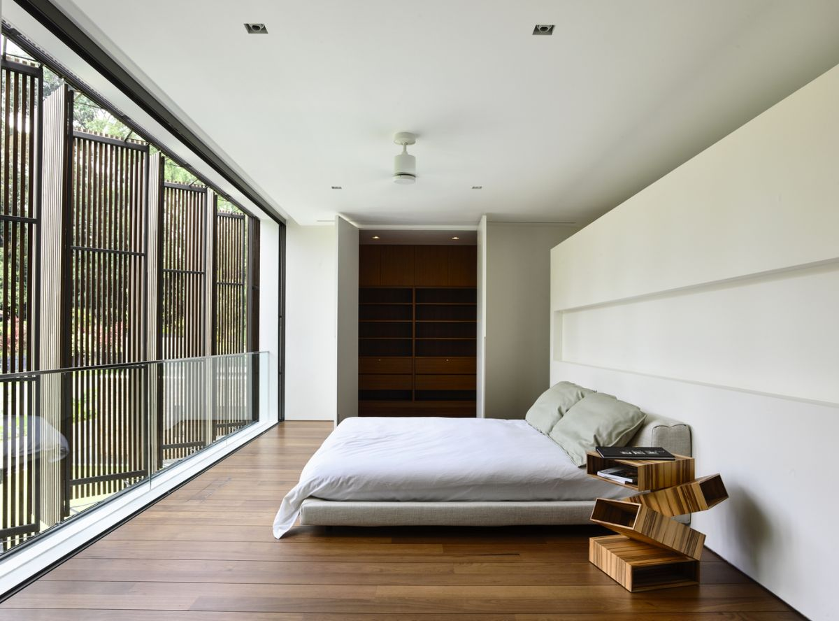 There are four bedrooms in total and they have large windows and timber screens for added privacy