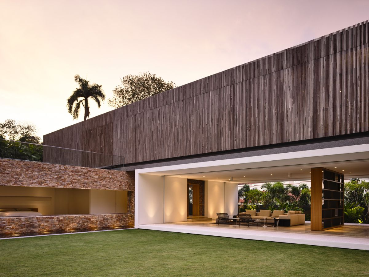 Here you can clearly see the stone, timber and white concrete volumes complementing each other