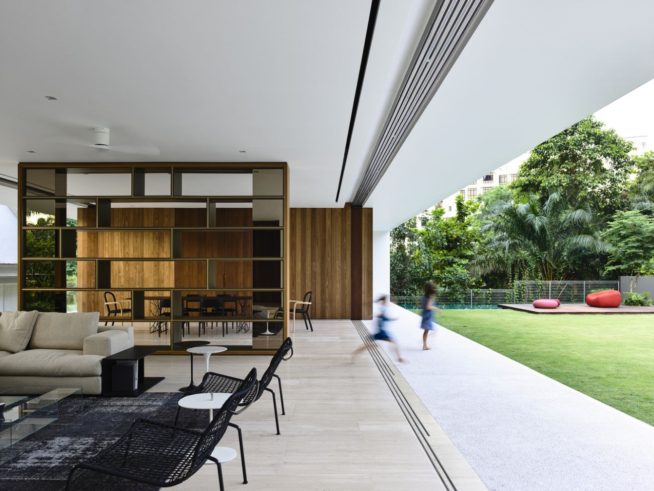 The ground floor living areas have floor-to-ceiling glass doors which are fully retractable