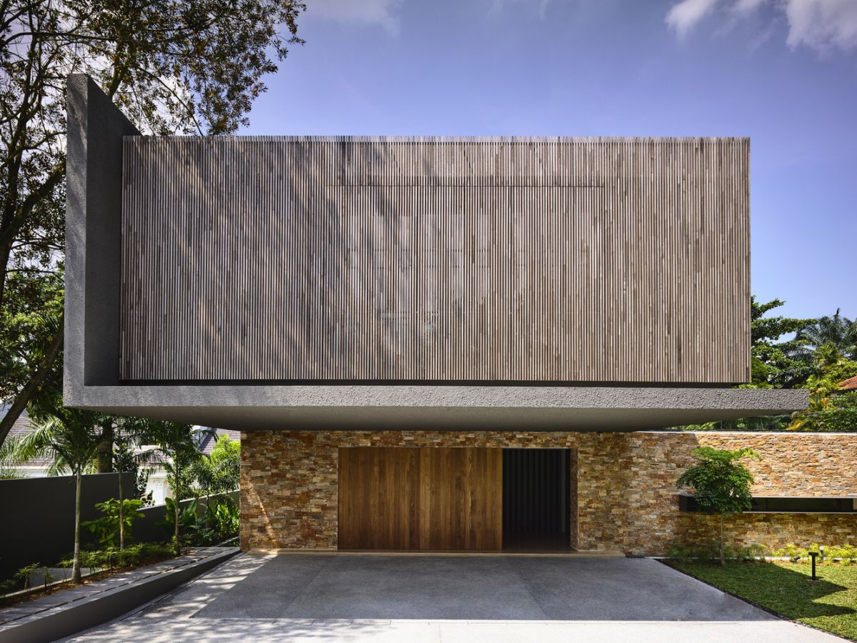 The lower section of the house has a stone-clad exterior with warm wooden accents