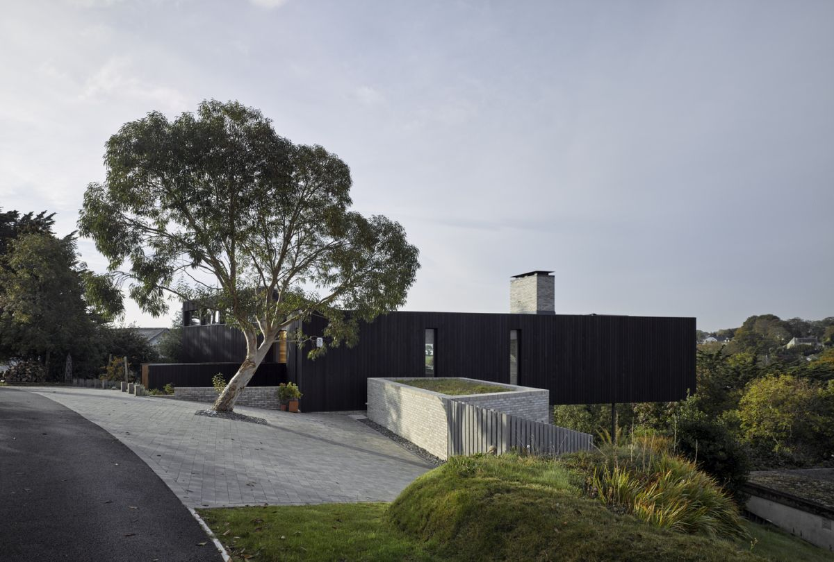 On the outside, the house is clad in dark timber which helps it blend into the landscape