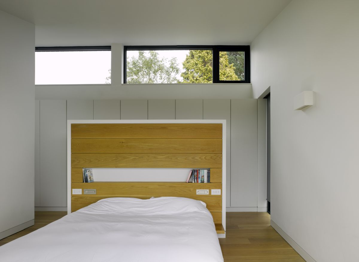 Clerestory windows bring natural light into this bedroom in a subtle but efficient way