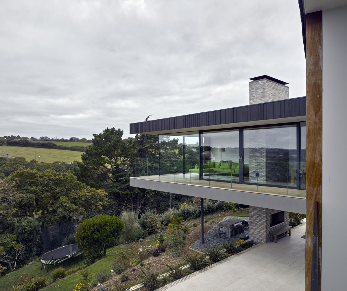 The chimney runs through the living room extending above and below the volume
