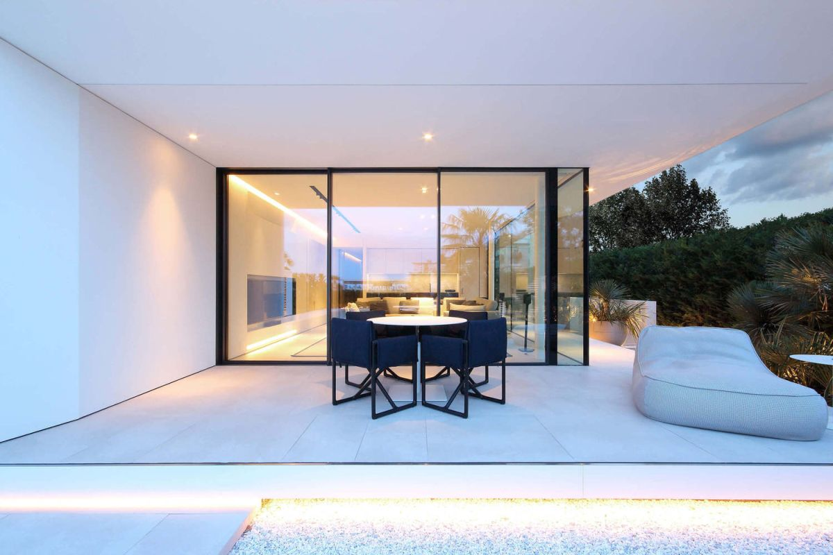 Sliding glass door open the indoor living areas onto covered patios with beautiful views of the surrounding landscape