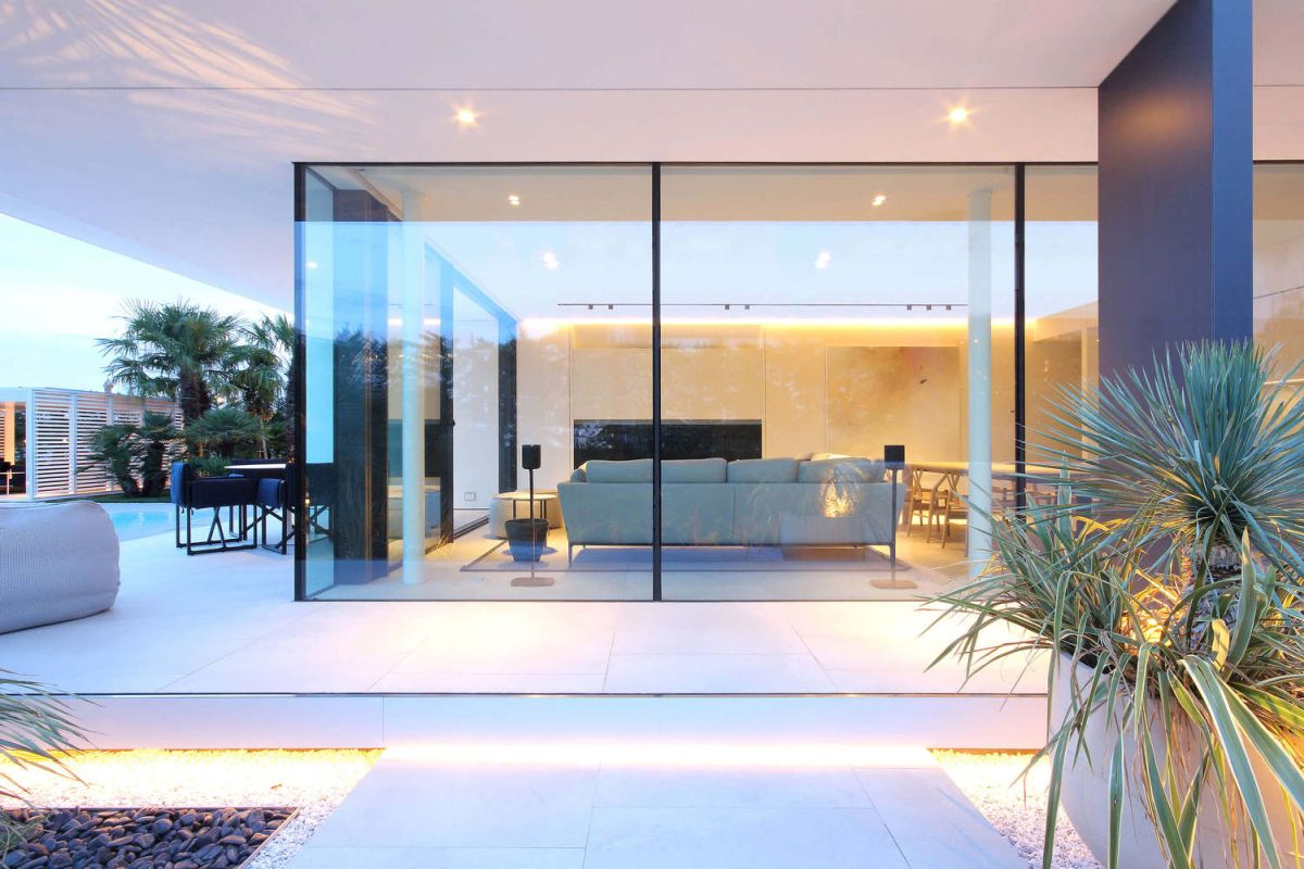 The indoor spaces get plenty of light through the glazed facades and respectively and sunken patios