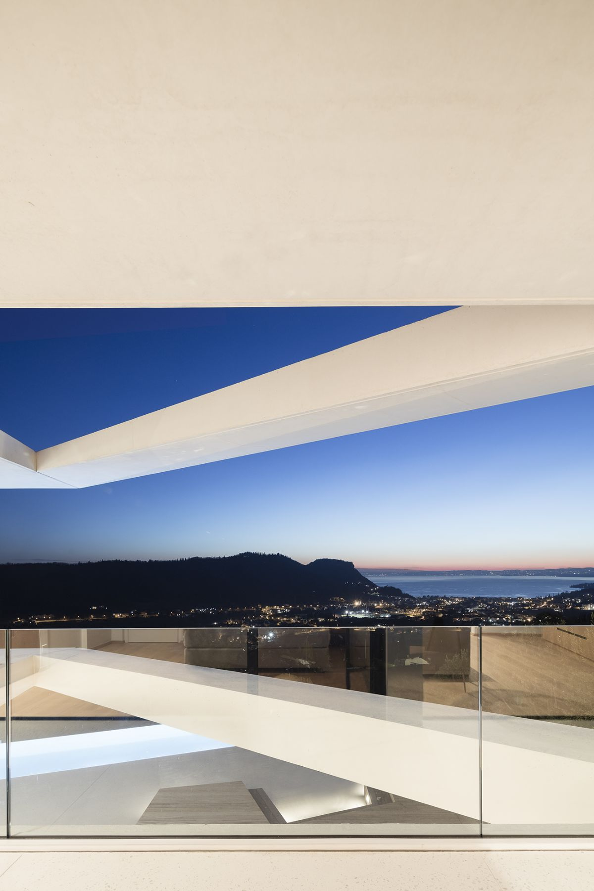 The cantilevered upper floor offers a beautiful view of the lake in the distance
