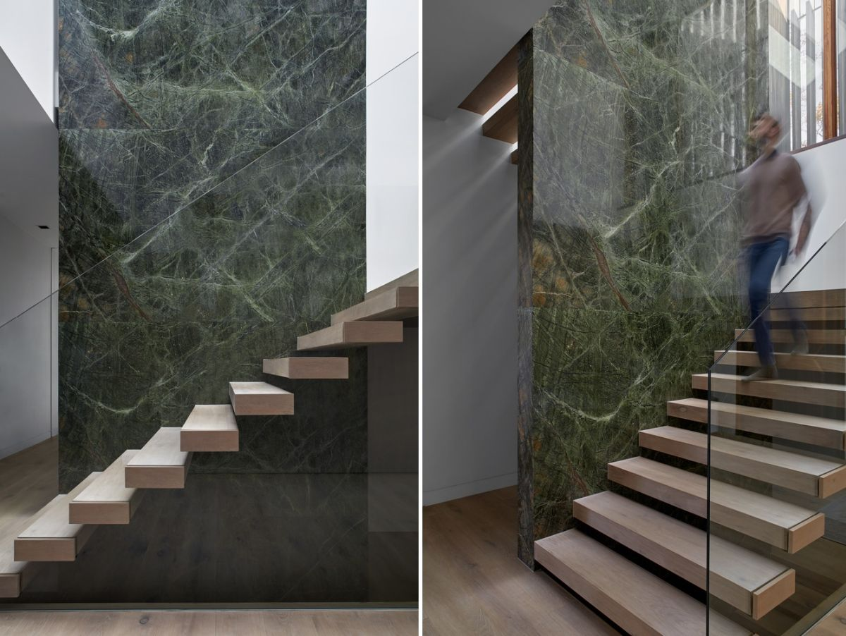 At the center of the house stands a large green stone column which a floating staircase wrapped around it