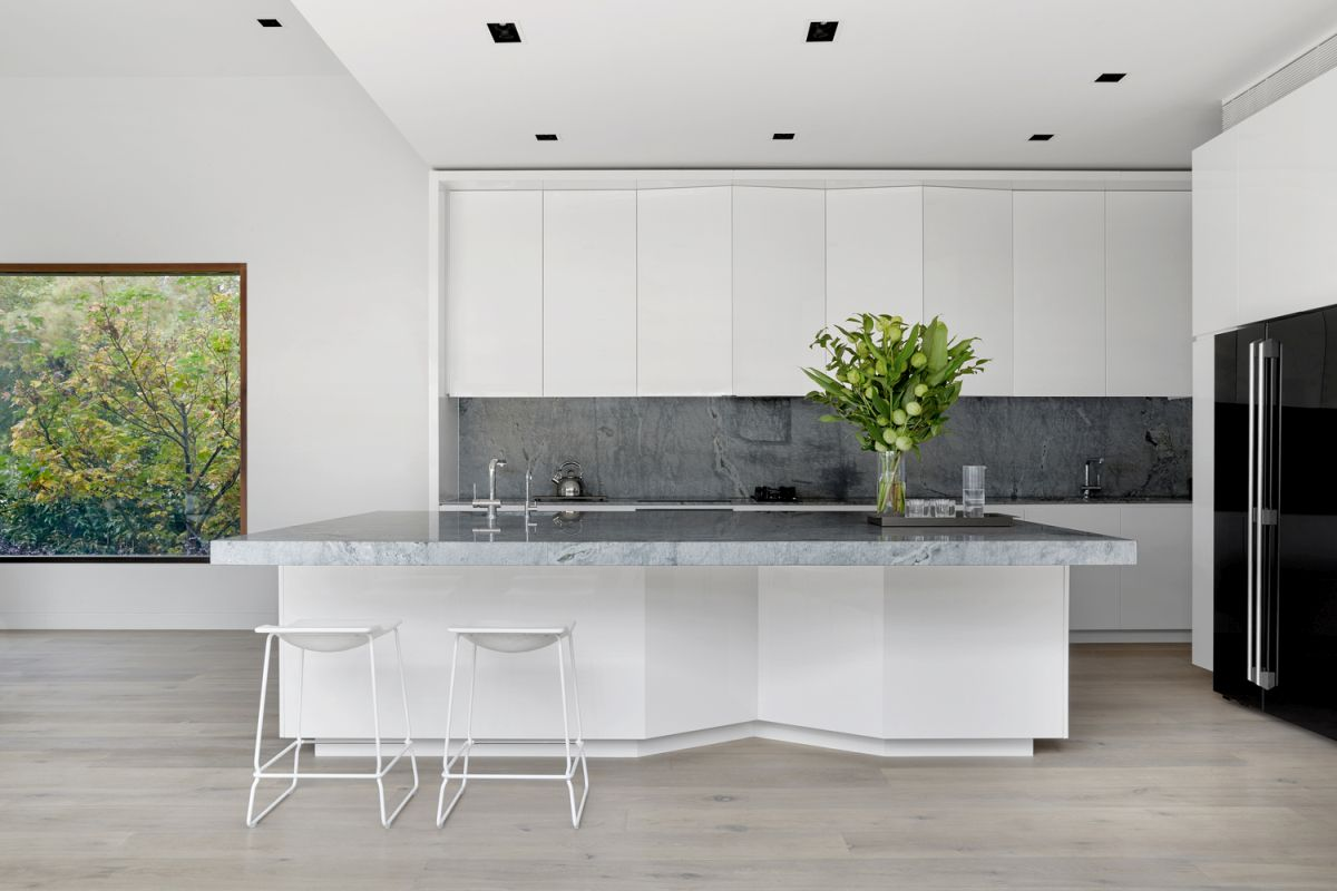 The interior design is defined by neutral colors and simple, natural materials
