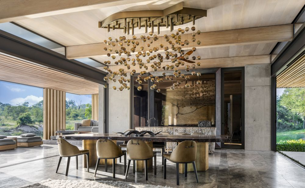 The high ceiling creates a sense of grandeur but with a focus on the immense beauty coming from outside