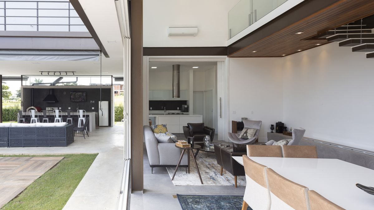 The living spaces are seamlessly connected to the outdoors through sliding glass doors and transitional areas
