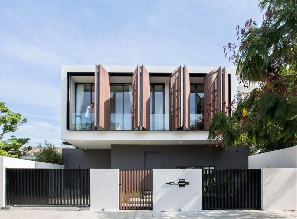 The folding wooden shutters coordinate with the front gate and break the monotony in the design