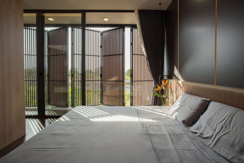 The bedroom situated on the upper level are connected by a small shared balcony along the facade