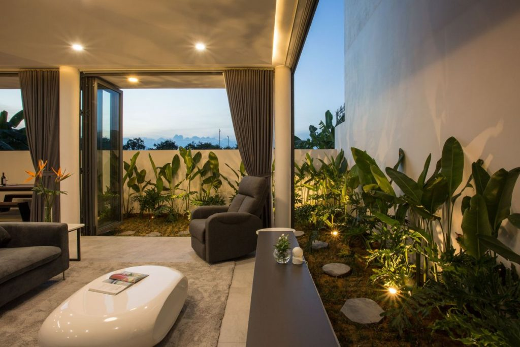 The living areas are connected to a series of small interior gardens which bring color and beauty into the decor