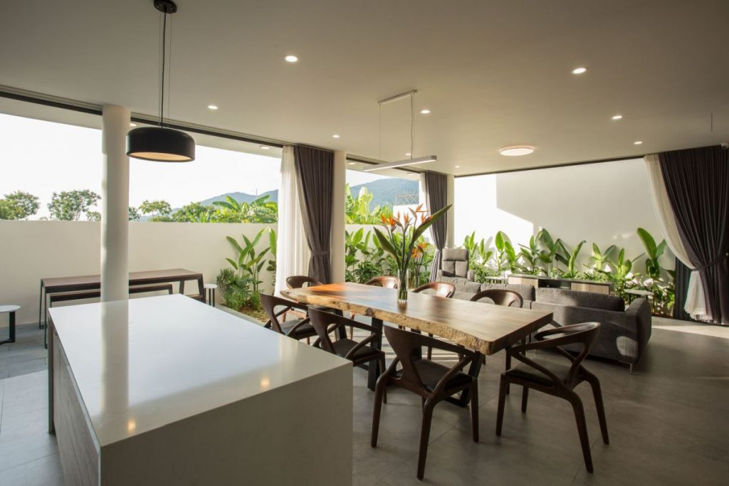 The kitchen, dining room and living area are all connected and have a very airy and breezy feel