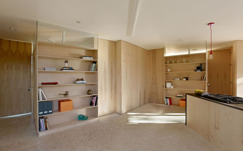 Unfinished plywood and OSB sheets were used for the interior of the house, keeping the design simple and the cost low