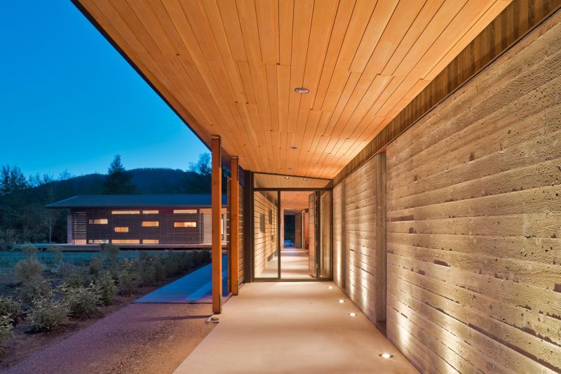 Decks and porches surround the house, forming buffer zones between the interior spaces and the outdoors