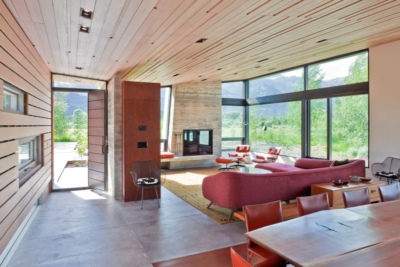 The interior spaces are lined with wood as well, ensuring a warm and cozy atmosphere