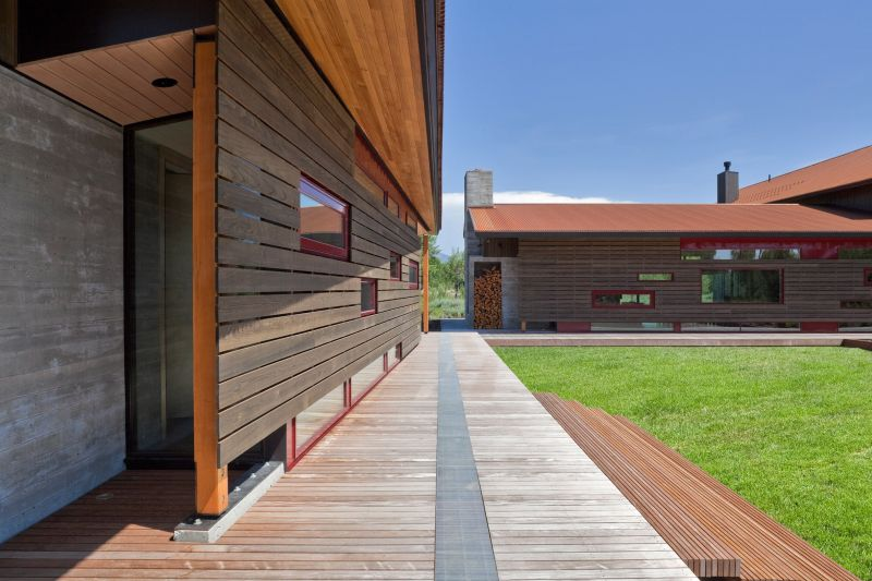 There's a partition wall made of wood which shelters the corridor and separated it from the deck