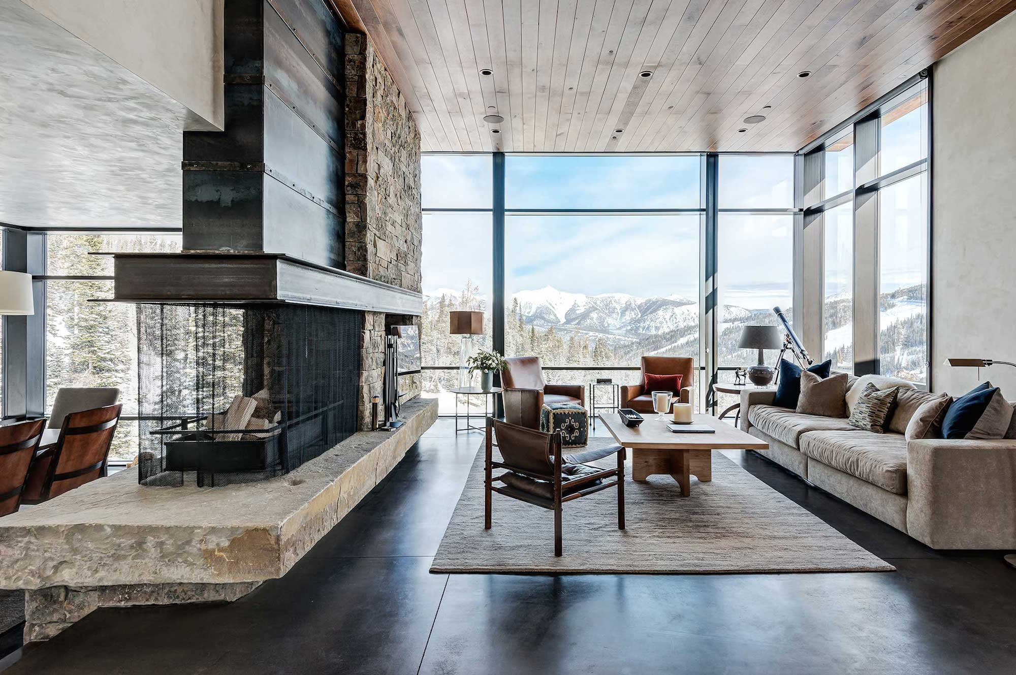 Most often, the fireplace divider separates the living room and dining area
