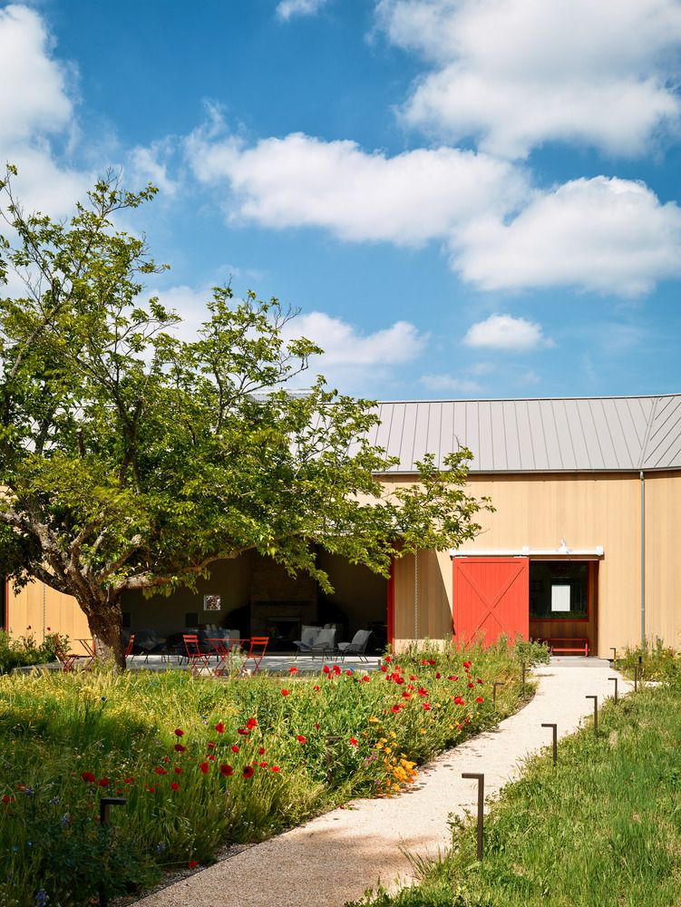 The red sliding barn door marks the main entrance into the pavilion