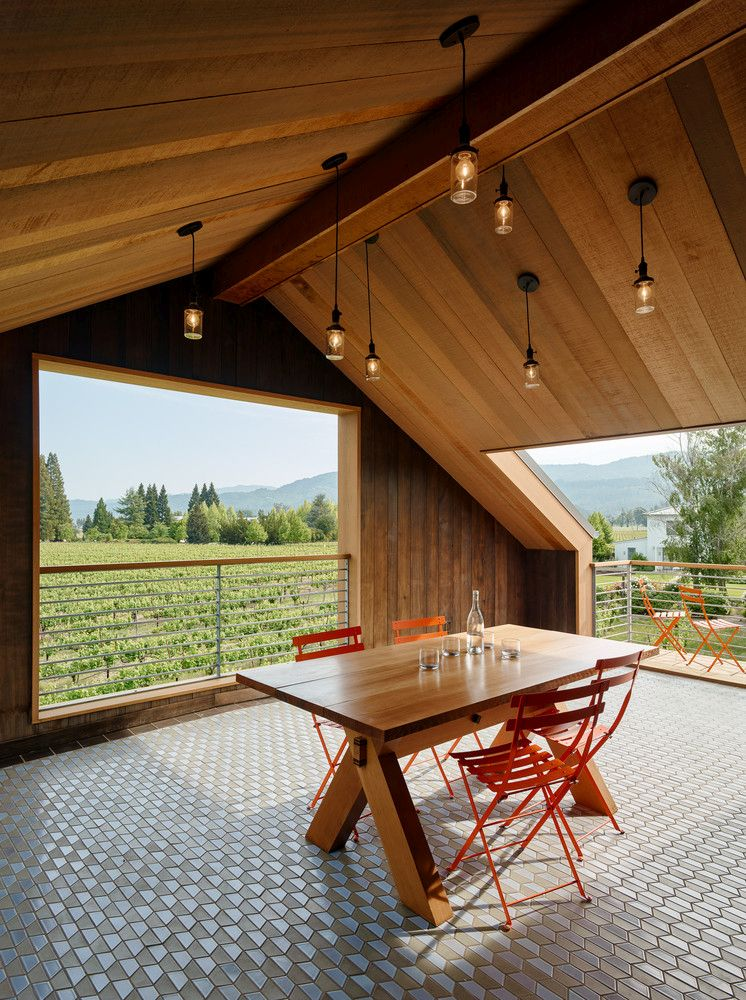 Large windows, porches and balconies frame the panoramic views of the vineyard