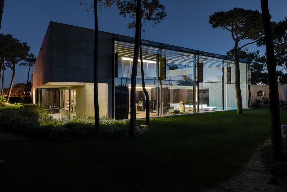The modern structure is sedate and blends well with the landscape.