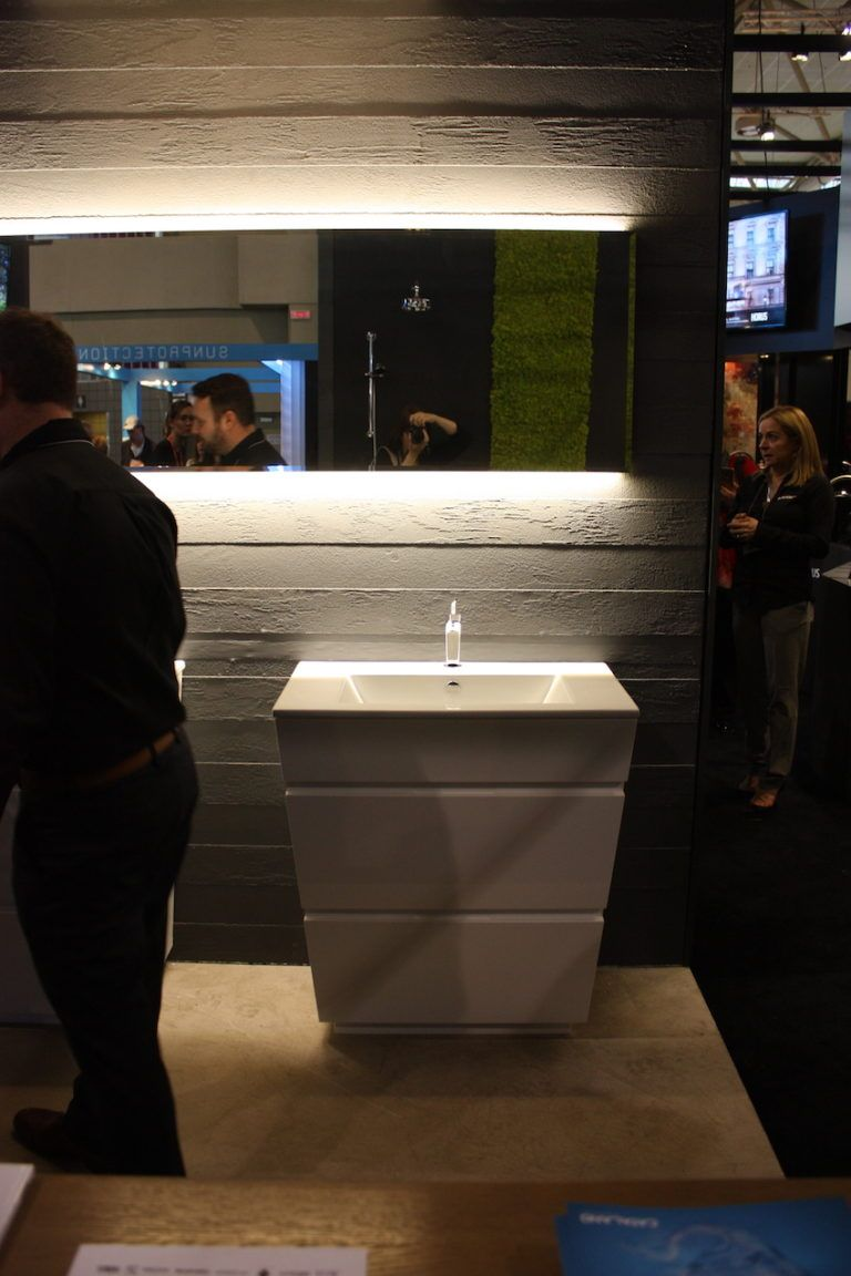 Underlighting works with all sorts of vanity and bathroom styles, as in this Nortesco design.