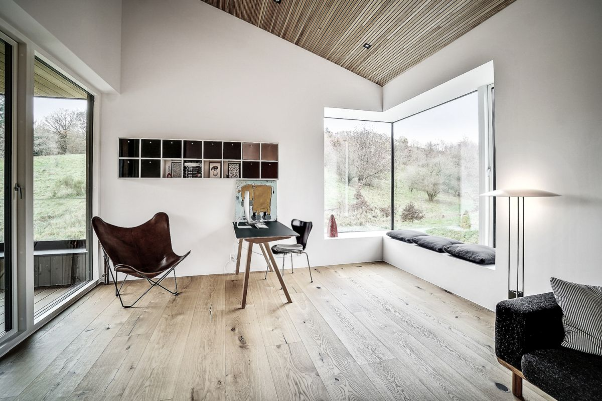 The views towards the forest and the lake are beautifully framed by large windows throughout the house
