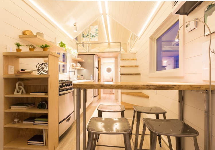 Inside the tiny house there's actually room for a full kitchen with plenty of storage