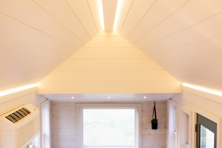 There's recessed lighting embedded into the outline of the roof