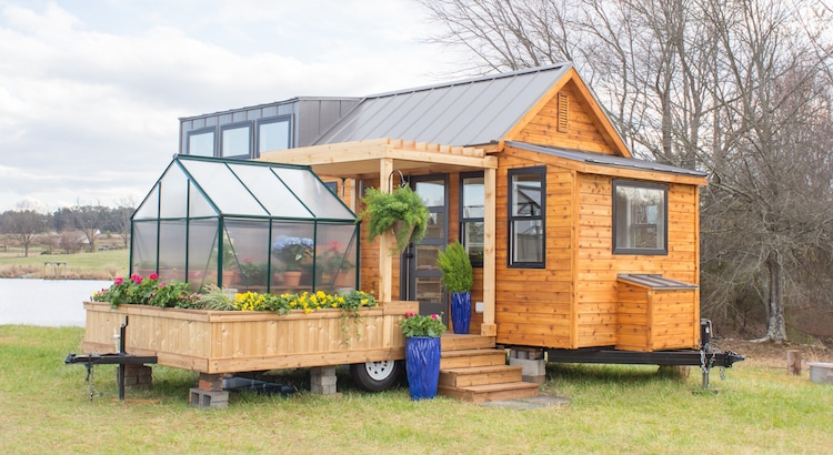 Both the house and the greenhouse attachments are built on trailers