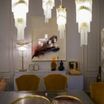 Opulent lighting fixtures above the dining table