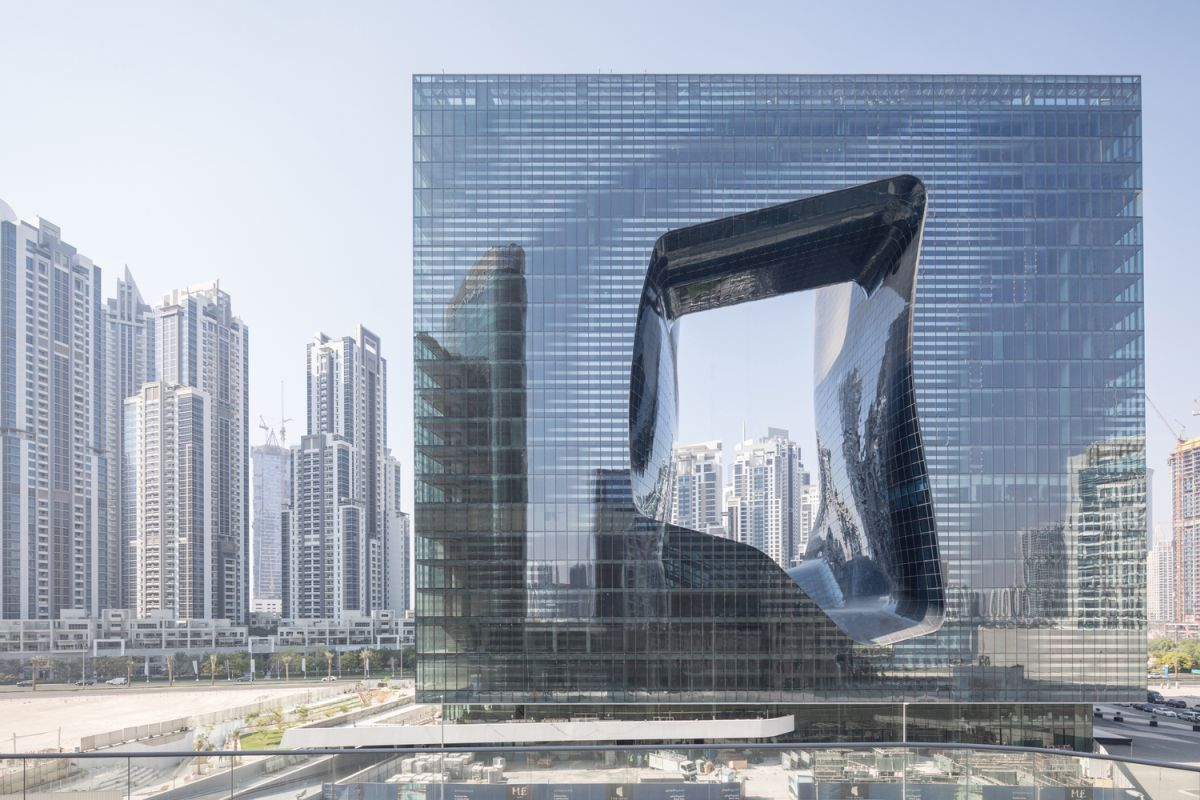 The clean geometric shape of the building contrasts with the freeform cut-out at the center