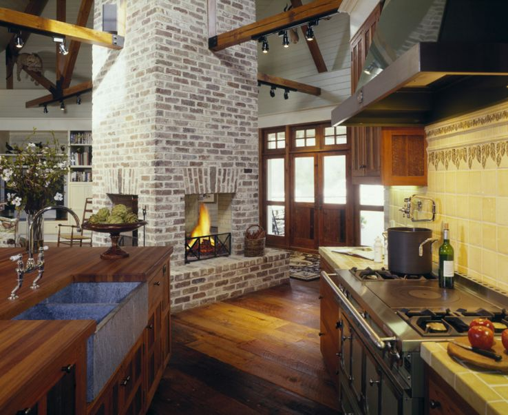 Painted brick fireplaces can be just as charming and can double as structural elements