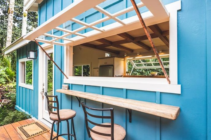 When open, this kitchen acts as an awning for the bar out on the deck