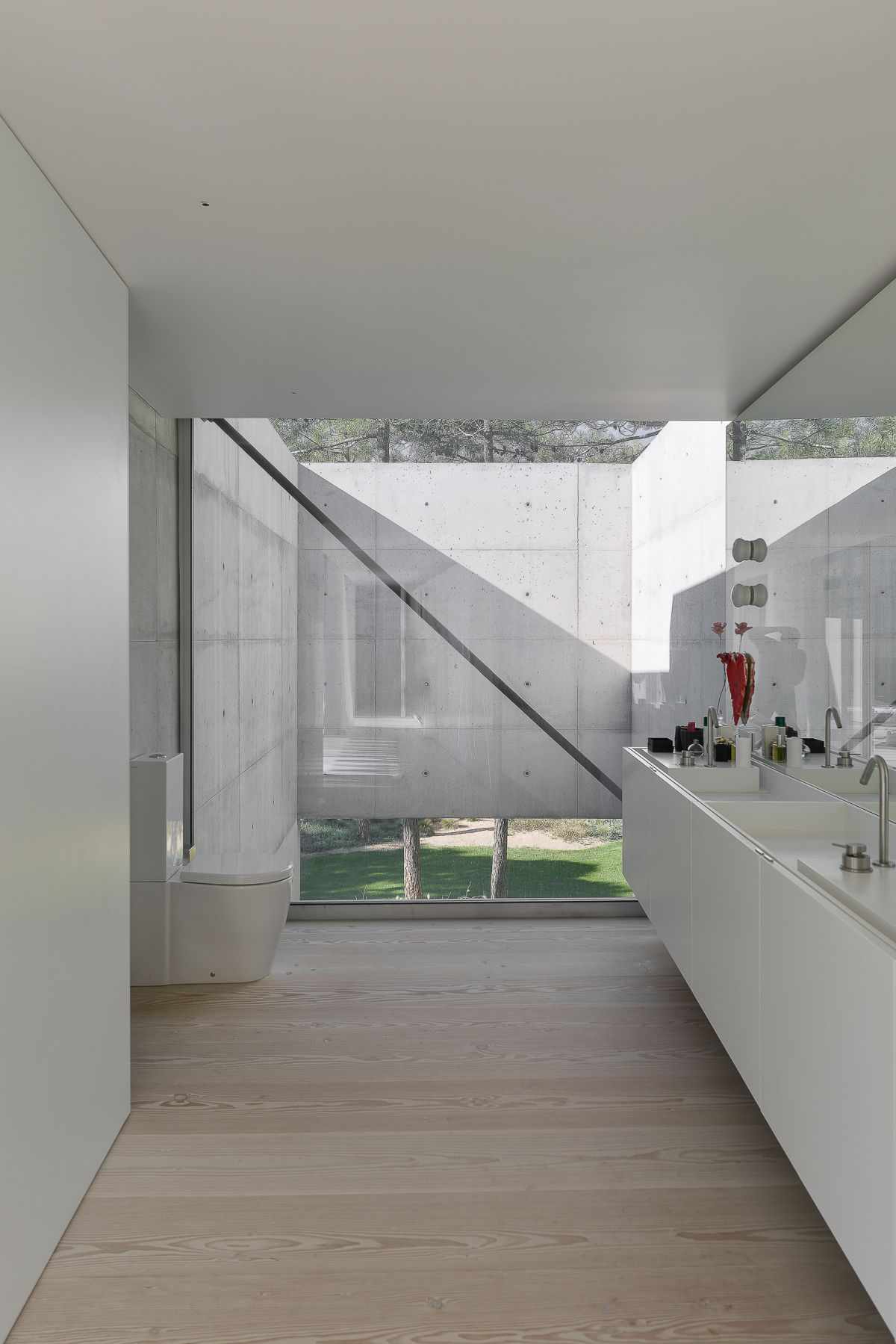 Part of the kitchen is bordered by the concrete structure outside