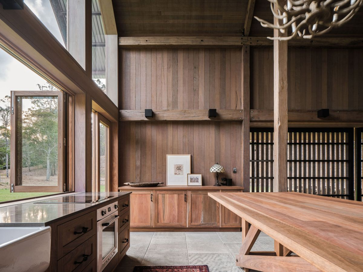 The kitchen has an open plan layout and transitions seamlessly into the dining and living areas