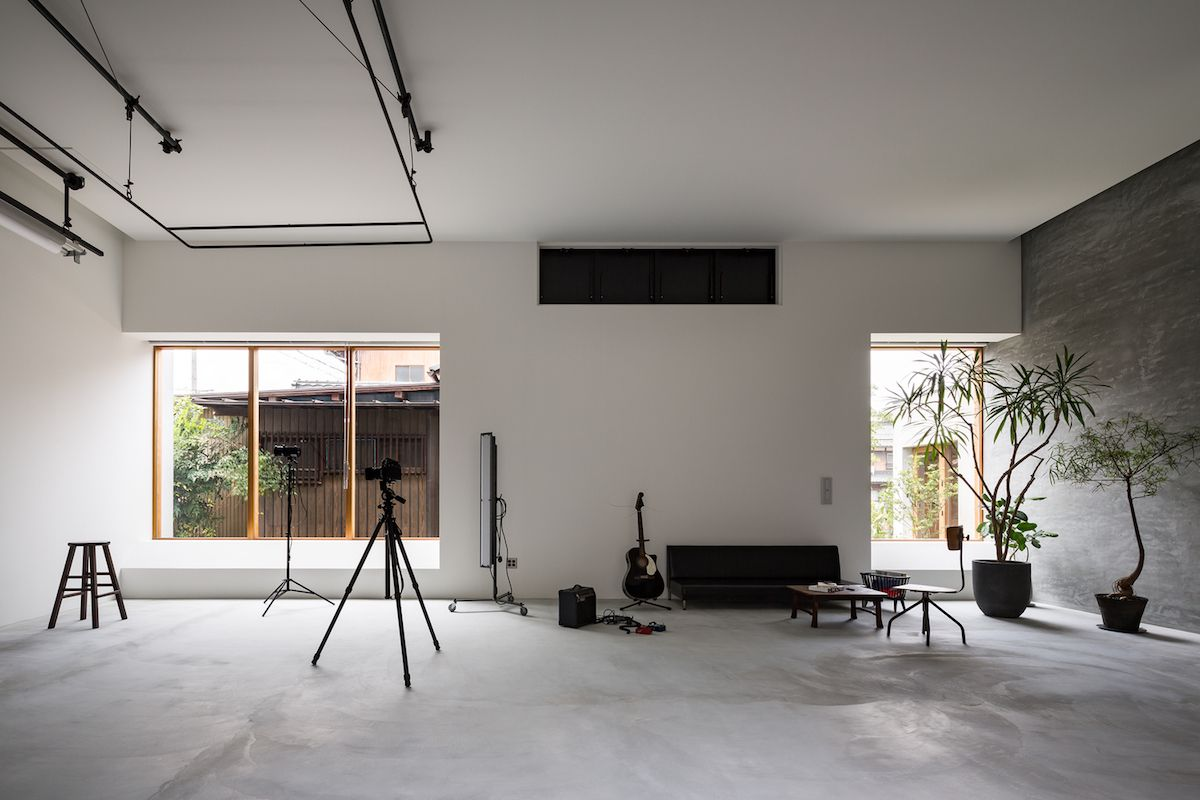 The interior is simple and almost austere, featuring polished concrete floors and bare walls