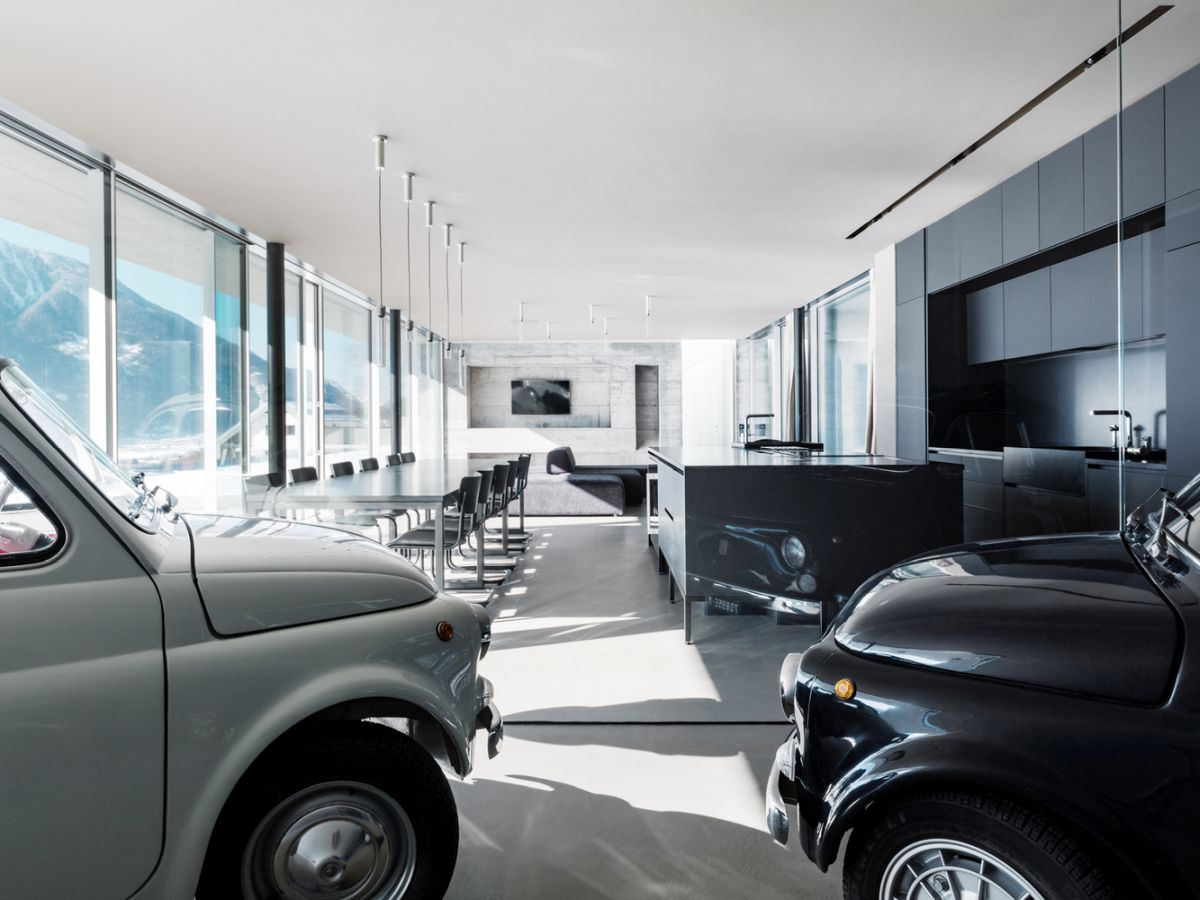 The living space is quite special as it includes this cool exhibition area for the cars