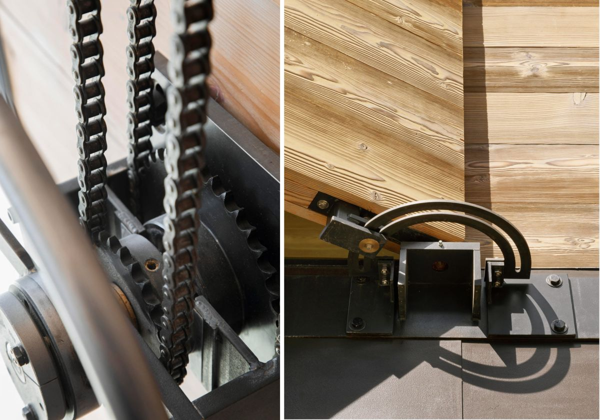 A closeup view of the pulley system used to operate the exterior wooden shutters