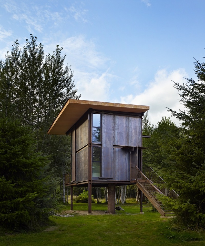 The cabin is raised on stilts for protection against floods and general dampness