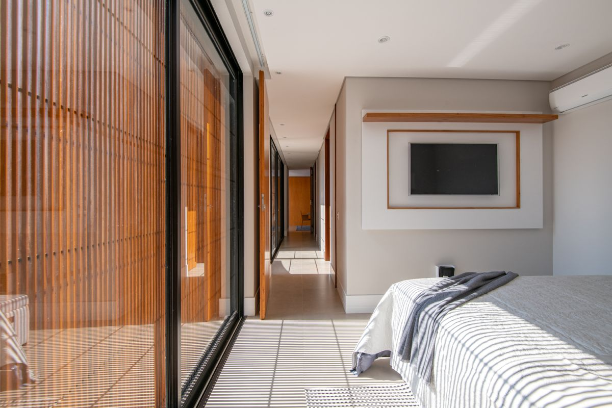 Wooden surfaces are scattered all over the house, adding warmth and color to the rooms