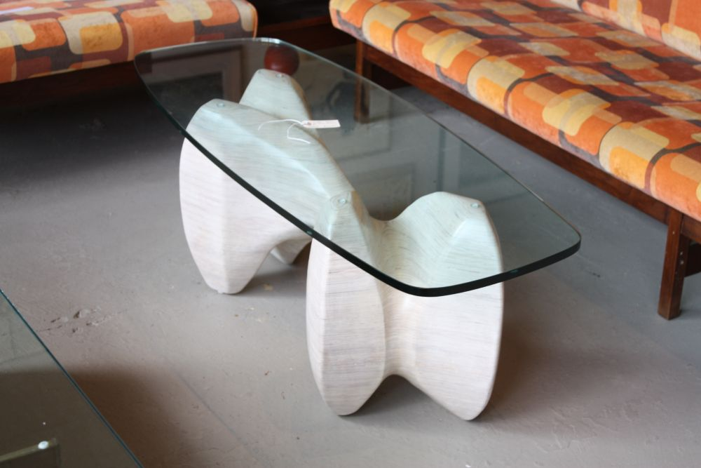 Although it doesn't have a round top, this table is a great central piece for modern living rooms