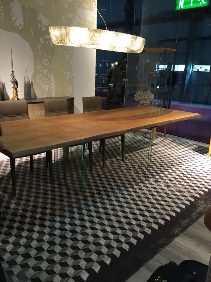 Rectangular dining table with wood top and glass base