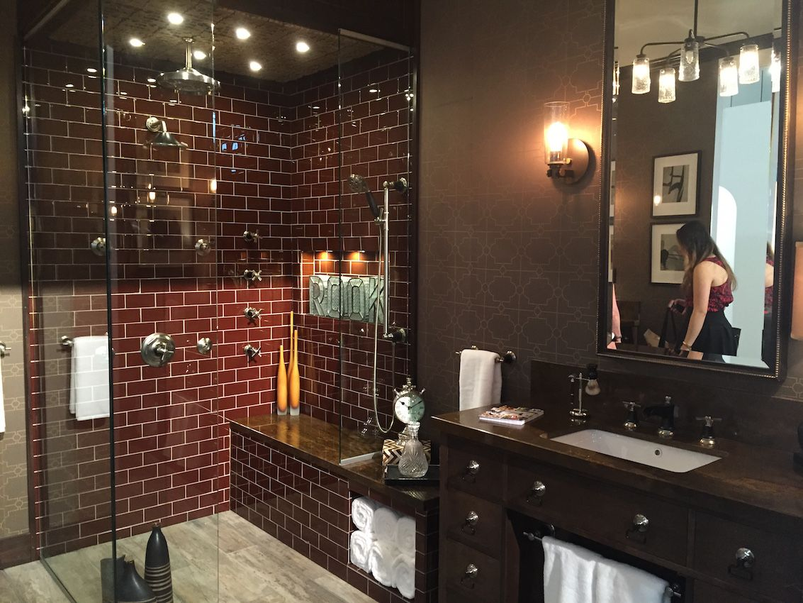 Small touches can boost the retro vibe and still have a modern feel. Check out the shower knobs on the tile wall and the fixture for the sink.