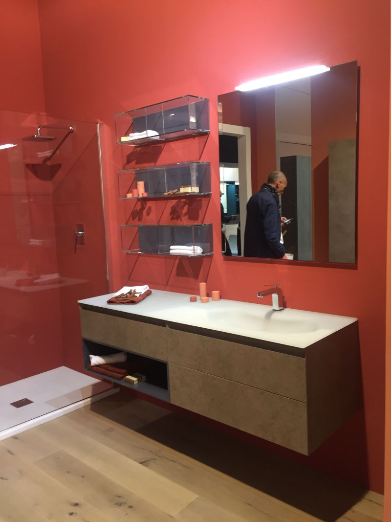 Red bathroom wall and floating vanity