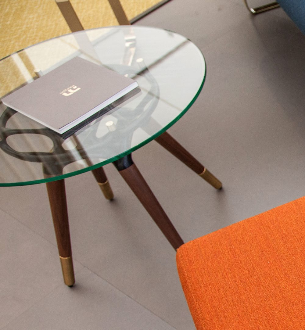 This is the Rio table, an elegant and versatile piece of furniture with a stylish glass top and metal-tipped legs