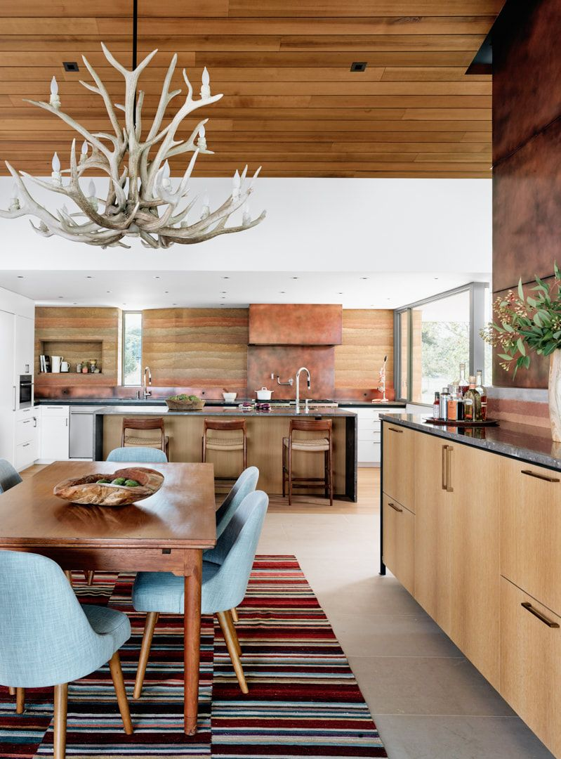 The dining area and the kitchen are decorated with warm mesa-inspired colors
