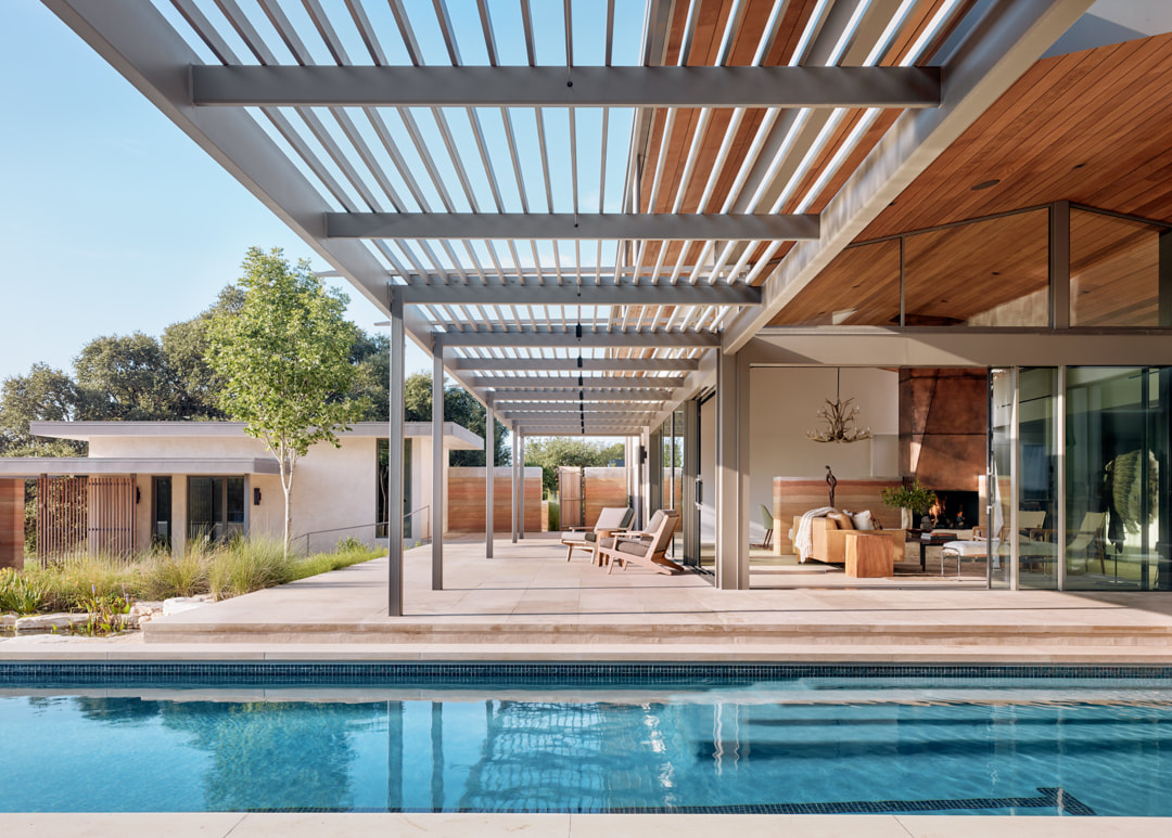 The pergola roof extends the outdoor living area further out into the courtyard